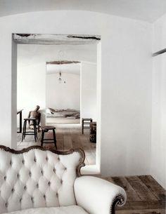 fancy sofa in simple rustic surroundings