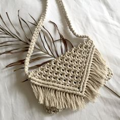 Hand-made macrame bag with fringing and strap made by Han from HANmademacrame.  It can also be used as a clutch bag by tucking the strap inside the bag.    Made with 100% cotton in natural colour.     Measurements:  - Width 27cm  - Height 18cm  - Length of strap 98cm