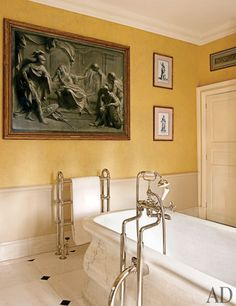 An 18th-century grisaille painting hangs in the master bath; the tub fittings are by Lefroy Brooks.