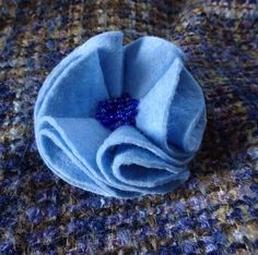 A personal favourite from my Etsy shop https://www.etsy.com/uk/listing/506177813/mothers-day-blue-brooch-blue-fabric