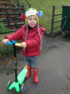 Loui wearing his Hunter Original Kids' wellies in red.