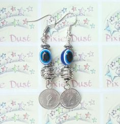 Blue glass eye beads & Coin Earrings :)  it's sold in Doha and 100 % profit goes to animal rescue charity in Qatar ♡ u can check out their Facebook page and instagram