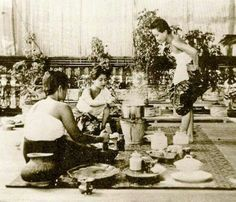 Bunnag [family] girls preparing a meal at the Dusit Palace, 1898