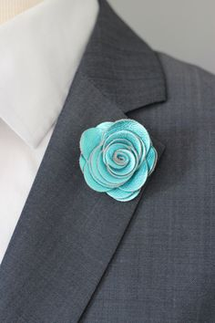 A personal favourite from my Etsy shop https://www.etsy.com/listing/209256875/turquoise-flower-lapel-pin-mens-lapel