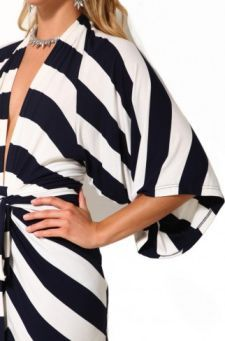Kimono sleeves are wide and have an open end that usually ends at the elbow.