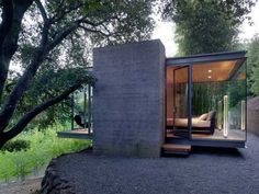 """A modern teahouse in Silicon Valley, CA where one can """"simply retreat into nature... under a grove of large California Live Oak trees."""" By Swatt Miers Architects"""