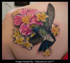 Image from http://www.tattooshunt.com/images/01/color-flowers-and-3d-hummingbird-tattoo-on-back-shoulder.jpg.