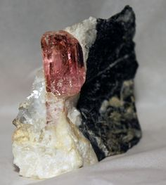 Pink Topaz in matrix, with termination. Find this and other collectibles at CuratorsEye.com.