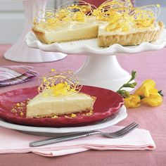 Lemon Velvet Tart  Dazzle your taste buds with the vibrant flavor of lemon. Drizzle Raspberry Sauce over your slice, if you wish.