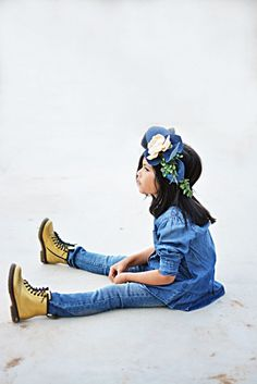 """Blogger Angie of """"Little Inspiration"""" says her daughter Ariel loves wearing boots with her Levi's Kids jeans. She says she """"feels tall and ready to have fun.""""  Add a little DIY denim floral crown to complete the head-to-toe denim look."""