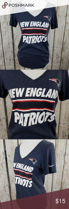 "Nike New England Patriots T Shirt Med Blue V Neck Nike New England Patriots T Shirt  Size Medium  Blue White Red V Neck Short Sleeve Excellent pre owned condition Good pre owned condition (All measurements are laying flat and approximate) Armpit to Armpit: 18"" Length: 27"" Nike Tops Tees - Short Sleeve"