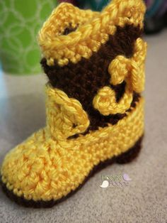 "https://hodgepodgecrochet.wordpress.com Cowboy Boots: Free Pattern - I changed the colors to pink and white and crocheted a pair of these ""booties"" for my granddaughter in 2013."