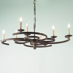 """Swirling Iron Candle Chandelier; Shades of Light, 13.4"""" H x 37"""" wide; 8 lights, Shades of Light, $575"""