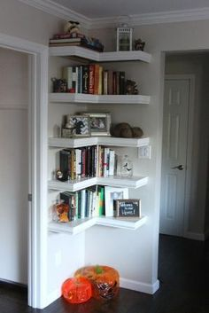 Corner shelves, I love how You can but a small corner in a really good use. I dont like a shelf facing only one side in a position like this and tall self would eat up the air around it, so I looooove it! by tiquis-miquis