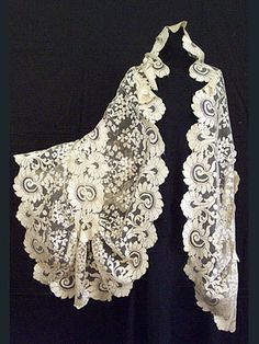 Handmade needle-run, triangular-shape silk lace shawl, c. 1860. Amazing.