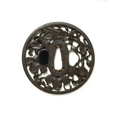 Sword guard. Place of origin: Hagi. 1700-1750. Artist/Maker: Yukinaka. Iron, with shakudo (patinated alloy of copper and gold) and copper