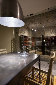This wine cellar, with hidden staircase, bespoke metal shelving and furniture, was slotted in under an existing beach front home. Beachfront House, Metal Shelves, Wine Cellar, Beach House, Dining Table, Bespoke, Furniture, Projects, Home Decor