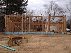 Walls complete and roof joists begun. Engineered i-joists easily handle the 20′ clear span.