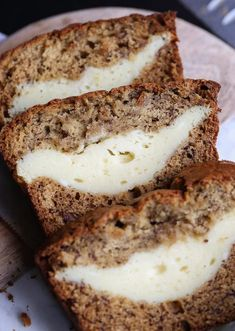 Cheesecake Stuffed Banana Bread…it's a classic treat turned on it's head. The thick ribbon of cheesecake is creamy, rich and the perfect pairing with the buttery banana bread! Banana Bread Cookies, Easy Banana Bread, Banana Cheesecake Bread, Banana Bread Cream Cheese, Apple Bread, Cake Cookies, Cupcakes, Just Desserts, Delicious Desserts