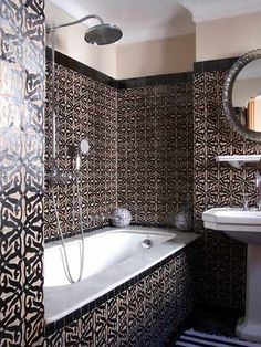 """Geometric Moroccan tiles, strong in both color and pattern, cover the majority of the walls in this striking Tangier hotel bath""""  AtticMag.com"""
