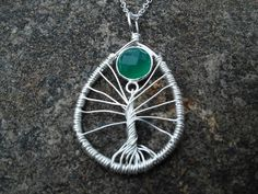 Check out this item in my Etsy shop https://www.etsy.com/listing/229919639/sterling-silver-tree-of-life-with-jade