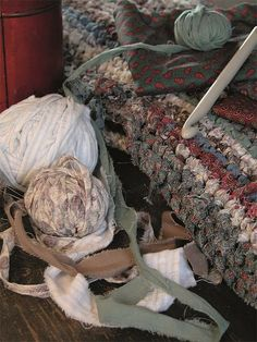 Upcycle cut strips from worn out clothing and use large crochet hook to make a rag rug