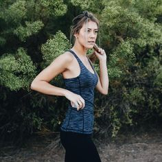 We created a performance tank with pockets because we understand not all of your workout pants have pockets. Feel confident in this sleek top during any workout or race! Fit and Product Description  Built in shelf bra with removable cups Side pockets to stash your phone and other necessities Follow size chart below (size down for a more snug fit) Tagless  XS: 0-2S: 4-6M: 8-10L: 12-14XL: 16 Fabric and Care  4-way stretch nylon/spandex blend that is breathable and wicks sweat Machine wa...