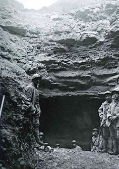 WW1, 1917-18. French soldiers standing at an entrance of the Caverne du Dragon. Collection ECPAD.