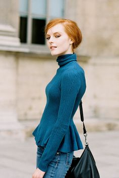 Love the combination of Karolines beautiful red hair with the teal blue peplum sweater.