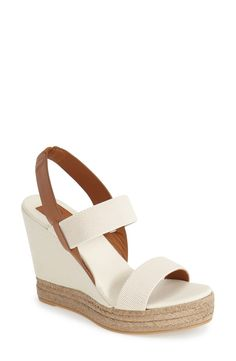 These Tory Burch wedges would look perfect with a white summer dress and a striped tote for a simple, nautical-inspired look.