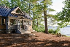 Lake House. Rustic Lake House with Metal Roof. Lake house with metal roof. The metal roof is a standing seam metal roof. #LakeHouse #RusticHouse #MetalRoof OLSON LEWIS + Architects.