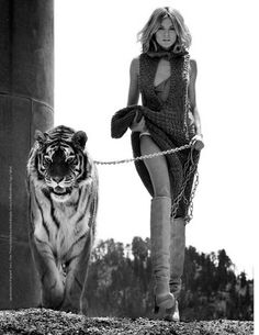 me, the wild animal trainer, casually walking with a gigantic 500lb.+ tiger on a leash... except not w/ the dress :P