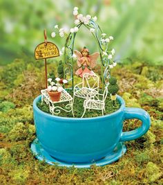 Am doing this! Use: largest teacup planter, rose fountain from Ann, tiny tea set, buy arbor at Hobby Lobby ... furniture ... mini books? ... doll from Dainty Dining?