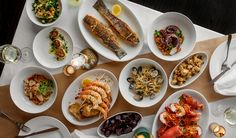 Feast of Seven Fishes: the Italian American. Feast of Seven Fishes menu includes Baccalà (salted cod fish), anchovies, whiting, lobster, sardines, smelts, eels, squid, octopus, shrimp, mussels and clams.