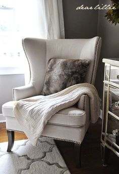 Early Fall House Tour  by Dear Lillie....THIS IS THE EXACT CHAIR I WANT FOR MY LIVING ROOM.. I ALSO LOVE THE MIRRORED DRESSER.  THE RUG IS BEAUTIFUL TOO.