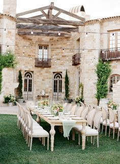 Outdoor wedding inspiration with wooden tables and beige dining chairs