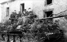 Northern France, A heavily camouflaged Panzer V (Panther) with infantry '44.