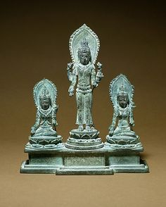 Standing Four-Armed Avalokiteshvara Flanked by Tara and Bhrikuti(?) Period: Central Javanese period Date: second half of the 9th–early 10th century Culture: Indonesia (Java) Medium: Bronze with silver inlay.