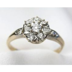Lovely tested platinum topped, 14kt yellow gold ring from Circa 1910. The cluster ring is prong and bead set with ten (10) Old European cut diamonds with a total diamond weight of .65 carats, a clarity range of VS2-SI1 and a color range of I-J.   Appraisal Value: $4775.