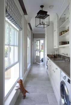 A mud room/laundry room combo makes great use of this elongated, narrow space