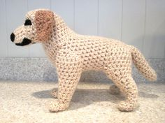 """All this little guy wants to do is curl up and snuggle with you.. He has the coloring and attributes of a realistic Lab. He measures 10""""L x 8""""H x 4W and is made from my own original pattern."""