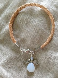 Leather bracelet with angel pendant made of glass beads