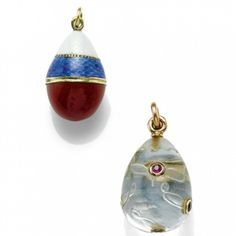 TWO FABERGÉ EGG PENDANTS - the first of rock crystal inset with ruby flowers flanked by incised leaves, stamped with workmaster's initials and KF in Cyrillic; the second, 1908-1917, enamelled in translucent white and blue above opaque red sections, 56 standard, stamped with workmaster's initials. via Sotheby's.
