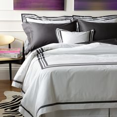 Three elegantly crafted rows of applique add a touch of exquisite boldness that perfectly contrasts the white percale, woven from the finest Egyptian cotton.