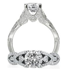 Masterwork diamond engagement ring featuring a prong set round cut centerstone with micropavé v design on the undergallery.  Beautifully finishing this piece is the micropavé interlocking criss cross design that adorns the shank.