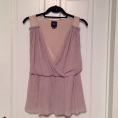 Anthropologie Top Fun blousy tunic top, sleeveless, by Deletta for Anthropologie. Looks pinkish on my iPad but it is a sage green. Made of cotton and modal. Has a Grecian flair! In excellent condition. Anthropologie Tops Tunics