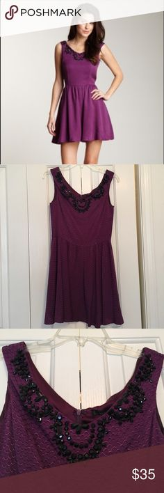 NWT Lucca Couture purple beaded flare dress New with tags! This dress has beautiful black beading on the front and is so soft- the material feels amazing and high quality. Lined with soft purple silk. Made in a fit and flare style that is flattering on all body types. Size M is about a dress size 6 and smaller! The weight of the tag has been pulling the size label off so I taped it to prevent further pulling (see pic. Color is accurate in the first photo. It's incredibly gorgeous, but too…