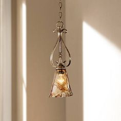 Charmingly designed, this mini pendant light boasts stunning silver finish highlights and a floral amber art glass shade.