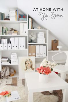 Love the loft ceiling and angled shelves, the white and pastel palette, and the gobs of roses.
