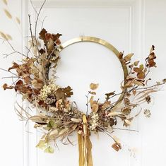 this beautiful brass wreath frame is made with dried flowers which reflect the glolden color of the frame, the warm colors make this look very autumnal Dried Flower Wreaths, Dried Flowers, Autumn Wreaths, Christmas Wreaths, Wreath Fall, Diy Christmas, L Eucalyptus, Paper Daisy, Dried Flower Arrangements